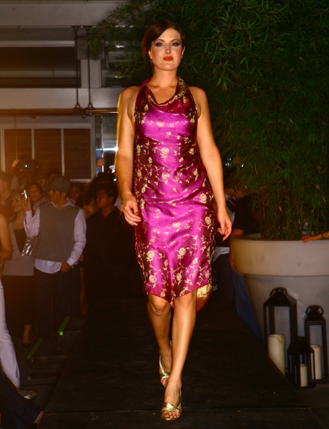 """Suede Salon, Spa and Boutique Runway Fashion Show by Tom Huynh /></a></p> <p>The Park Ultra Lounge, Sacramento<br /> Thursday, June 26, 2008</p> <p>Suede Salon and Spa is becoming a cornerstone for the Sacramento fashion scene. On June 26 they hosted another show, adding to their runway resume. This time, the event took place at The Park Ultra Lounge in downtown Sac. Three of Sacramento's most recognized designers were showcased, coupled with a Suede Salon custom look, making for a night of runway magic. </p> <p>With the music pumping hard, the Park was rampant with fashion fans itching to get the show started. If you've never been to the Park, it opens up into a three-room space giving partygoers plenty of breathing room. Yet, on this night, despite the extra room, an eager audience swamped the runway creating cramped quarters. This was definitely not an event for the claustrophobic. </p> <p>Benzo Couture set the show off with her """"Socialite"""" collection. Designs that hearkened back to the 1980s were revamped as Benzo put a contemporary spin on some throwback styles. Benzo models flaunted tight corsets attached to full skirts detailed with huge bows and lace making for dresses that will surely make you stand out in a crowd. Mercedes Ben's pieces were fully equipped with the intricate details one would expect to find in a couture collection. </p> <p>Casey Sue Douglass honed in on her niche of making clothes for the modern, urban woman. A wide array of funky patterns featuring jersey knit and silks made up separates and dresses. Especially charming were the heart shaped cut outs gracing the back of many of her pieces. Douglass describes her collection as """"Ready to wear couture""""¦the piece you can put in your backpack and wear later."""" </p> <p>If the name of the game is fashion, then you can be sure Dee Aguilar will be in attendance. On this night she stayed true to the season's trends offering up light summer dresses donning bright colors. The collection featured short """